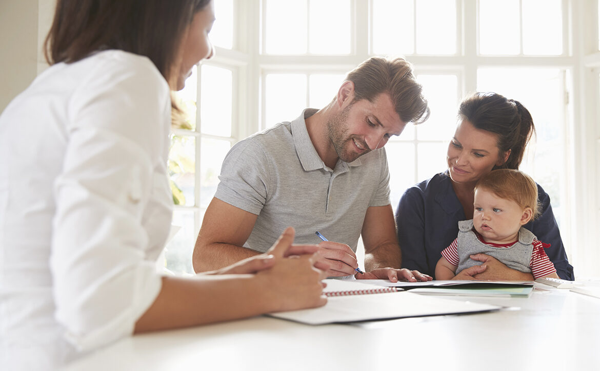 Family With Baby Meeting Financial Advisor At Home